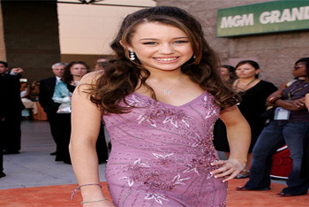 A 14-year-old Cyrus arrives at the 41st Annual Academy of Country Music Awards in 2006