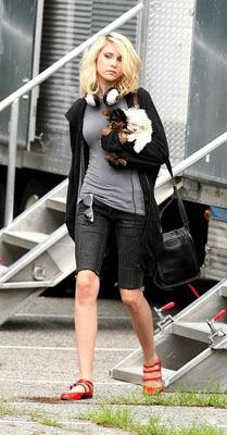 Taylor Momsen in dark bermuda shorts