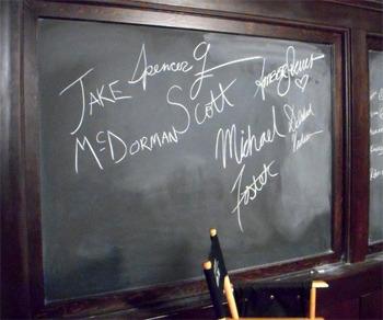Greek cast sign the calkboard