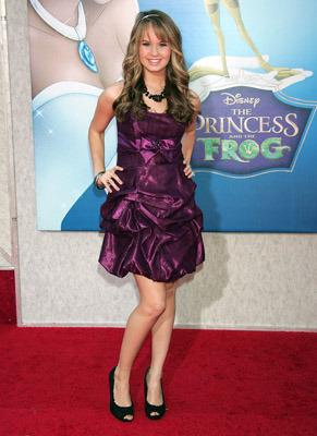 In a purple party dress