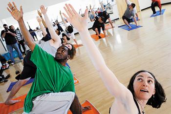 Football Teams practicing yoga