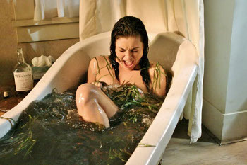 While taking a bath in Henry's cabin the tub fills up with mud