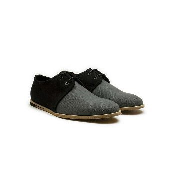 These two-tone oxford shoes complete your Christmas party look, $78.00 at Urban Outfitters