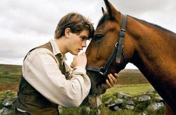 Jeremy Irvine plays Arthur, a farm boy with a special bond to a horse
