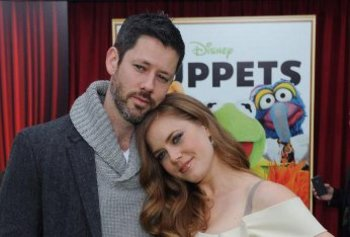 Amy and her husband at the premiere of The Muppets