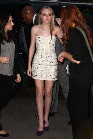 In a simple cream dress with a bit of sparkle