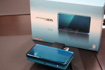 blue Nintendo 3DS and boxes
