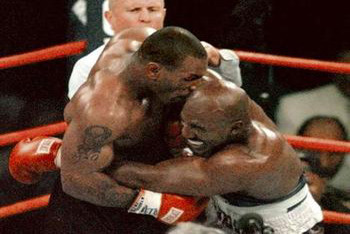 Mike Tyson biting Evander's Ear