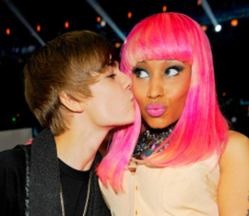 Justin Bieber gives Nicki a smooch for the audience!