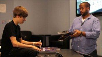 Justin Bieber Signing Autographs
