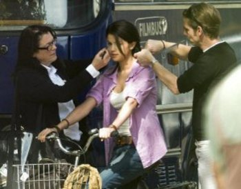 Selena gets make up done before shooting a scene