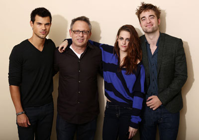 The cast with their director
