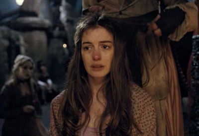 Anne as Fantine getting her hair cut