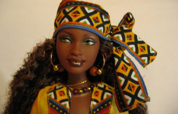 Some people wear traditional African clothing for Kwanzaa (just like this Kwanzaa Barbie)