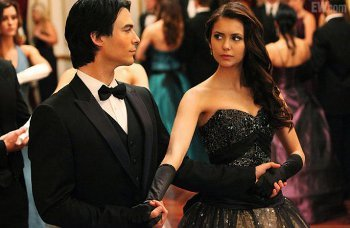 Damon is over protective of Elena - but still gets the first dance
