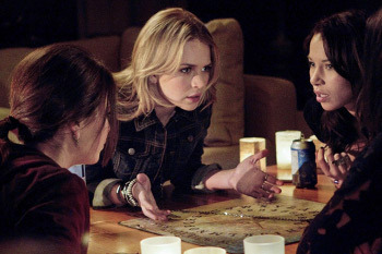 The girls bust out the Ouija board at Faye's slumber party