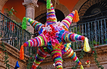 Traditional Mexican pinatas are decorated with fringed tissue paper