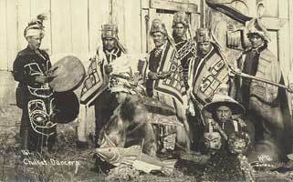 Chilkat dancers pose in ceremonial dress