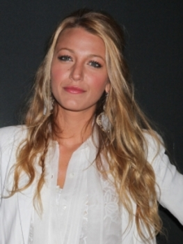 Blake Lively shows off her tall, thin frame with a long, white tunic
