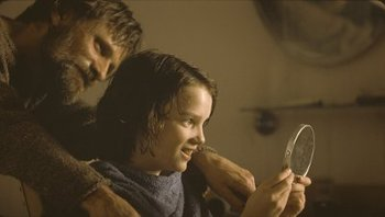 """Younger Kodi with Viggo Mortensen in """"The Road"""""""