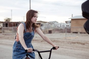 Kay as Alison rides her bike