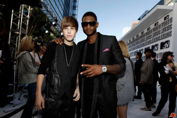 Usher signed singing sensation Justin Bieber