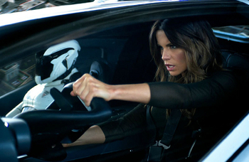 Kate Beckinsale drives a flying car