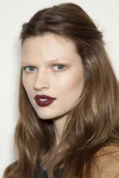 Gucci's natural makeup accented by a mulberry-colored matte lipstick