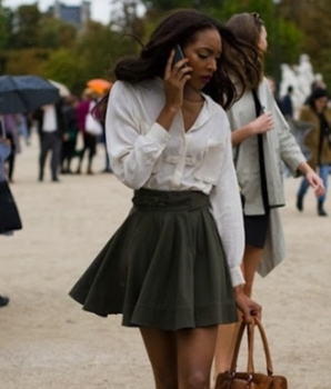 British model (and Virgo) Jourdan Dunn in an A-line skirt and button down