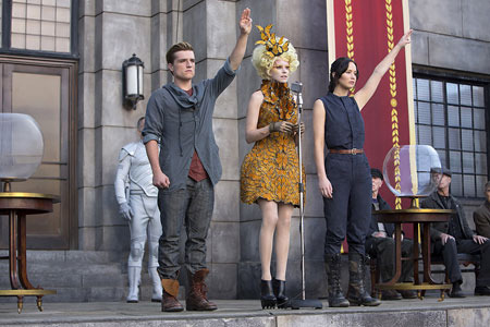 Peeta and Katniss on Victory tour with Effie