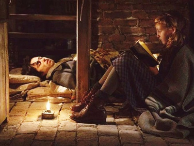 Liesel reads to Max a Jewish refugee