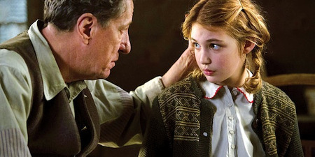 Hans (Geoffrey Rush) finds out Liesel (Sophie) can't read