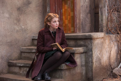 Liesel reading on her steps