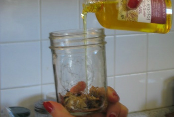 Cover the Herbs With Jojoba Oil