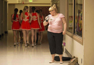 Rebel as Malerie checks out the cheerleader pack