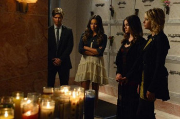 Jason and the liars pay their respects in the mausoleum
