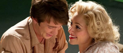 Emmy in full Marilyn Monroe mode with Thomas Mann (Link)