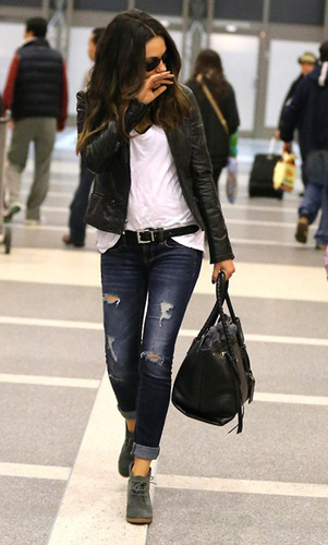 Get the grunge look with a leather jacket and ripped jeans.