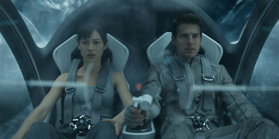 Olga with Tom in the bubbleship in the film