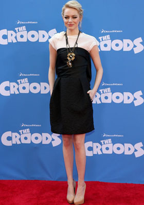 Emma Stone layers a white t-shirt under a black dress