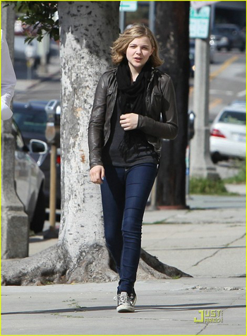 Chloe Moretz pairs her sneakers with a leather jacket.