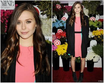 Elizabeth in a chic, simple pink dress.