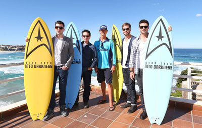 """Zac Quinto (left) and some cast with """"Trek"""" surfboards"""