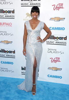 Kelly Rowland shimmers in metallic silver