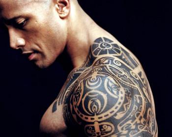 The Rock has a tribal design tattoo