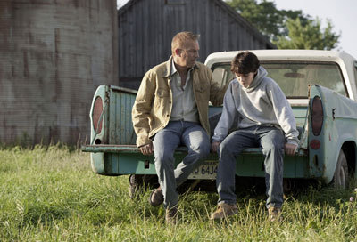 Kevin Costner as Jonathan Kent with Dylan as Clark
