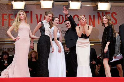 Emma, with the cast and Sophia Coppola, blows a kiss