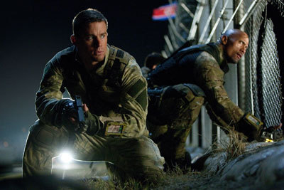 Channing and Dwayne break into a compound