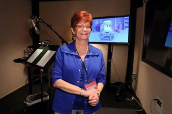 Reporter in sound recording booth with Dottie on the screen