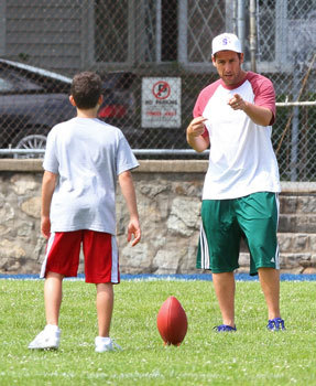 Adam teaching son Cameron to kick the football